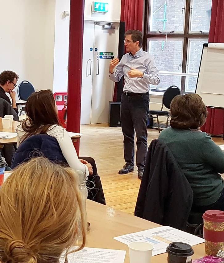 David running a finance workshop